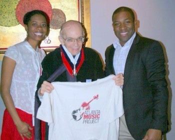 Maestro Jose Antonio Abreu poses with AMPlify co-founder/director Aisha Moody and AMP co-founder/director Dantes Rameau in Los Angeles in 2012.