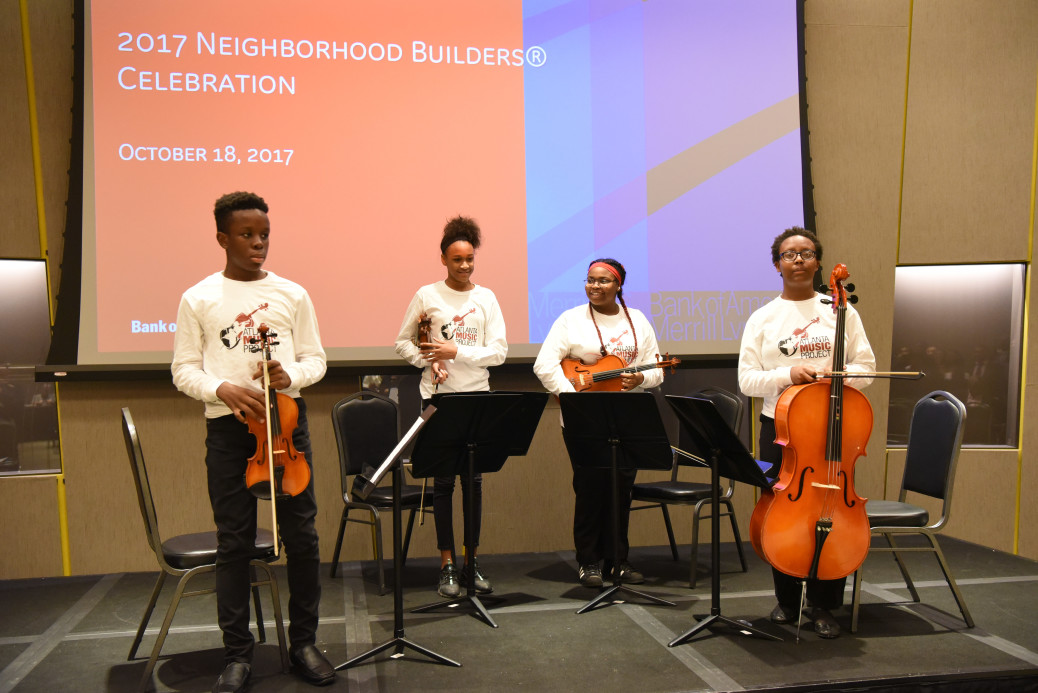A string quartet of AMP young artists take a bow at the National Center for Civil and Human Rights following performance for the 2017 Bank of America Neighborhood Builders Award. Photo by Zachary Toth.