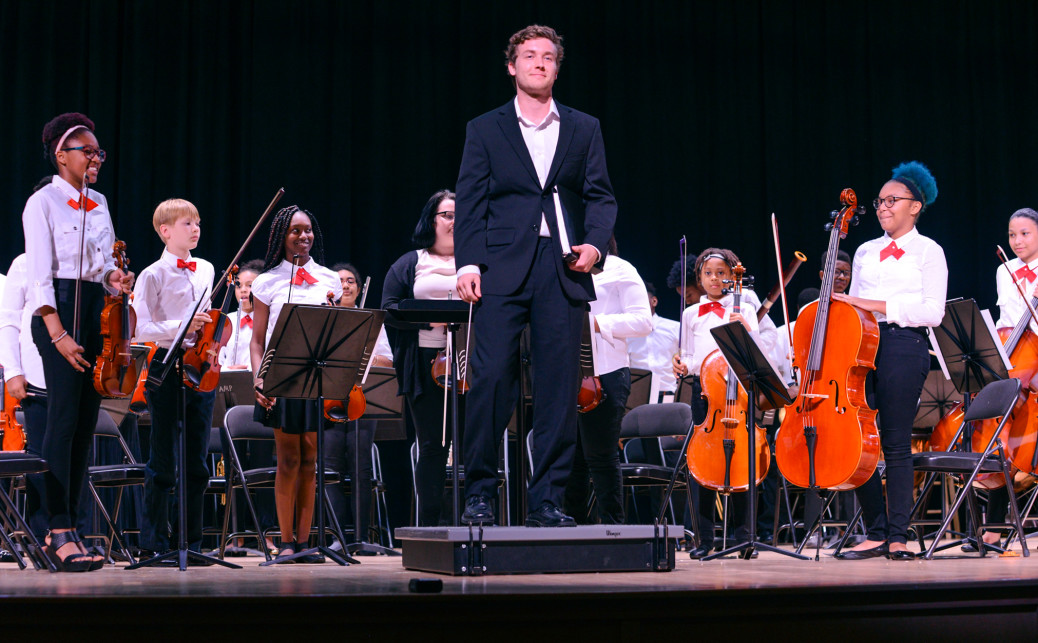 Conductor Logan Souther takes a bow with the AMP Summer Series Philharmonia Orchestra. Watch Mr. Souther lead the new AMP Junior Youth Orchestra sponsored by Cricket Wireless on December 15.