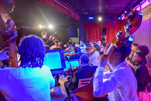 """The AMP Senior Youth Orchestra under the direction of conductor Logan Souther received performing """"Open Spaces"""" an original work by Nicole Neely, commissioned for the 2019 Luminary Awards."""